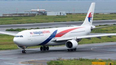 Photo of Reizigers Malaysia Airlines gestrand door Adele