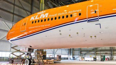 Photo of KLM Boeing 777 met vlag en wimpel; oranje boven